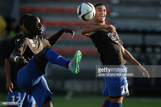 Nice's Algerian forward Said Benrahma ans teammates warm up prior to the French L1 football match between Angers and Nice on August 29 2015 at the...