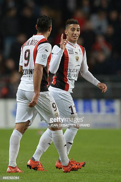 Nice's Algerian forward Said Benrahma celebrates with his teammate Nice's French forward Hatem Ben Arfa after scoring a goal during the French L1...