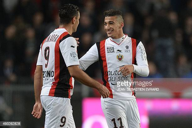 Nice's Algerian forward Said Benrahma celebrates with teammate Nice's French forward Hatem Ben Arfa after scoring a goal during the French L1...