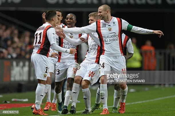 Nice's Algerian forward Said Benrahma celebrates with teammates after scoring a goal during the French L1 football match between Rennes and Nice on...