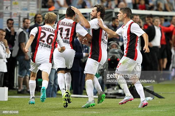 Nice's Algerian forward Said Benrahma is congratulated by teammates after scoring a goal during the French L1 football match Bastia against Nice on...