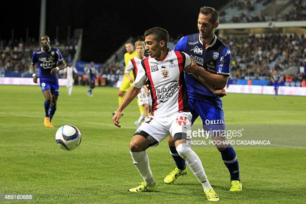 Nice's Algerian forward Said Benrahma vies with Bastia's French defender Florian Marange during the French L1 football match Bastia against Nice on...