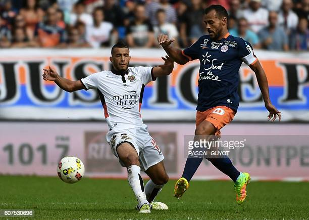 Nice's Algerian forward Said Benrahma vies with Montpellier's Brazilian defender Victorio Hilton during the French L1 football match between MHSC...