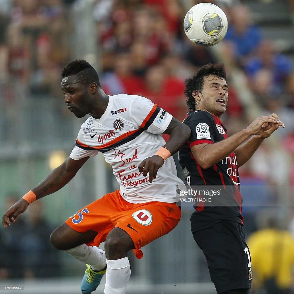 Nice's Argentinian forward Dario Cvitanich (R) vies with Montpellier's defender Siaka Tiene (L) during the French L1 football match between Nice and Montpellier, on September 1, 2013 at the Ray stadium in Nice, southeastern France.