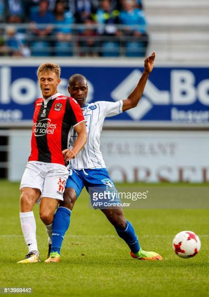 Nice's Arnaud Souquet and Gent's Anderson Esiti vie for the ball during a friendly football match between Belgian first league soccer team KAA Gent...