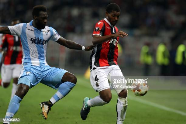 Nice's Brasilian defender Santos Marlon vies with Lazio's forward from Equador Felipe Caicedo during the UEFA Europa League football match between...