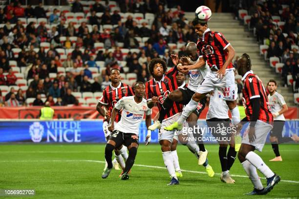 Nice's Brasilian midfielder Danilo Barbosa head the ball during the French L1 football match between OGC Nice and Amiens SC at the Allianz Riviera...