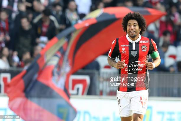 Nice's Brazilian defender Dante celebrates after scoring a goal during the French L1 football match Nice vs Nantes on February 18 2018 at the Allianz...