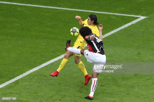 Nice's Brazilian defender Dante clears a ball under pressure from Paris SaintGermain's Uruguayan forward Edinson Cavani during the French L1 football...