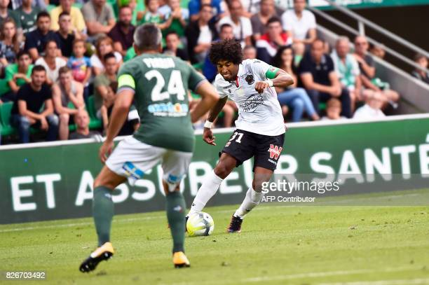 Nices Brazilian defender Dante Costa Santos runs with the ball during the French L1 football match between Saint-Etienne and Nice on August 5 at the...