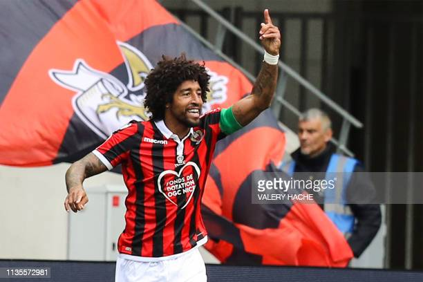 Nice's Brazilian defender Dante gestures as he celebrates after scoring a goal during the French L1 football match between Nice and Montpellier on...