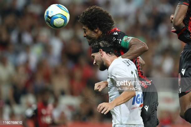 Nice's Brazilian defender Dante heads the ball and scores a goal during the French L1 football match Nice vs Amiens on August 10 2019 at the Allianz...
