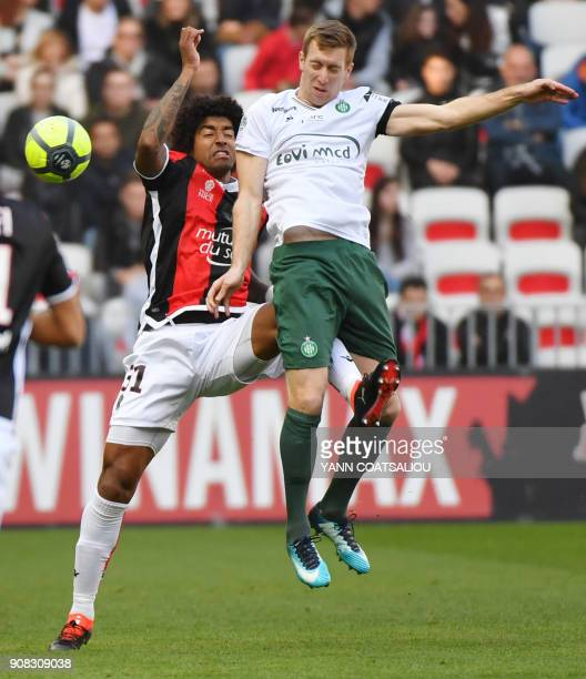 Nice's Brazilian defender Dante hits SaintEtienne's Slovenian forward Robert Beric during the French L1 football match between Nice and Saint Etienne...