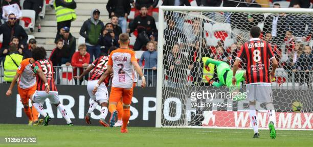 Nice's Brazilian defender Dante scores agoal during the French L1 football match between Nice and Montpellier on April 7 2019 at the Allianz Riviera...