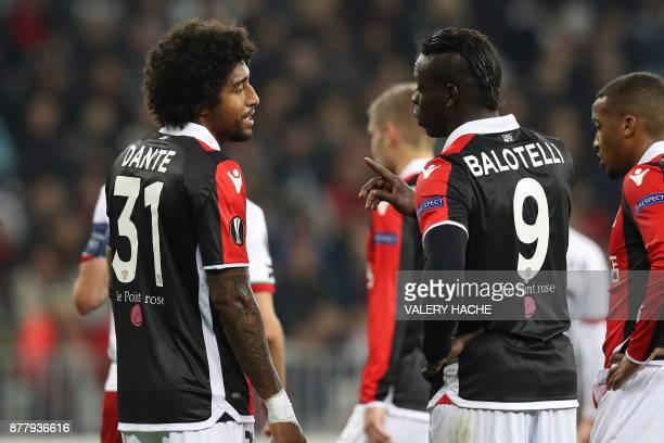 Nice's Brazilian defender Dante speaks to Nice's Italian forward Mario Balotelli during the UEFA Europa League football match between OGC Nice vs SV...
