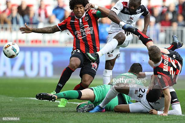 Nice's Brazilian defender Dante vies with Guingamp's French midfielder Yannis Salibur during the French L1 football match Nice vs Guingamp on January...