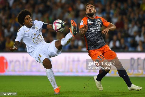 Nice's Brazilian defender Dante vies with Montpellier's French forward Andy Delort during the French L1 football match between Montpellier and Nice...