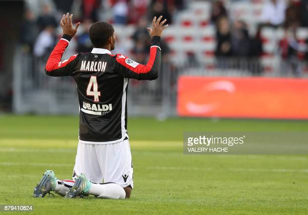 Nice's Brazilian defender Santos Marlon reacts during the French L1 football match Nice vs Lyon at The 'Allianz Riviera' Stadium in Nice southeastern...