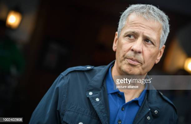 Nice's coach Lucien Favre looks on as his players warm up prior to the international soccer friendly match between Borussia Moenchengladbach and...