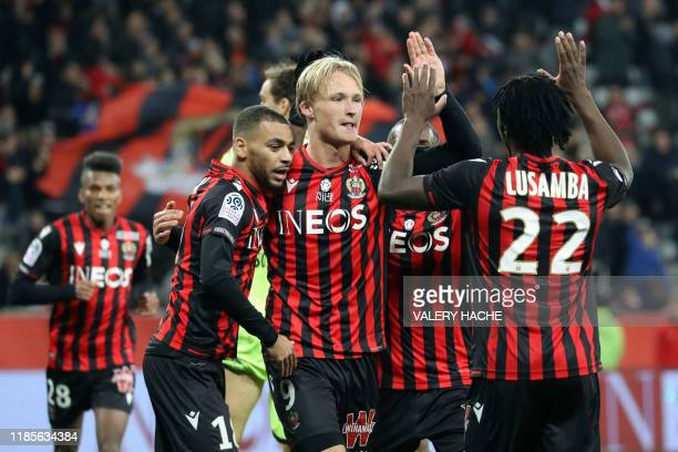Nice's Danish forward Kasper Dolberg celebrates with his teammates after scoring a goal during the French L1 football match between Nice and Angers...