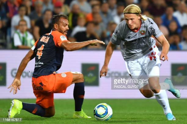 Nice's Danish forward Kasper Dolberg vies with Montpellier's Brazilian defender Vitorino Hilton during the French L1 football match between...