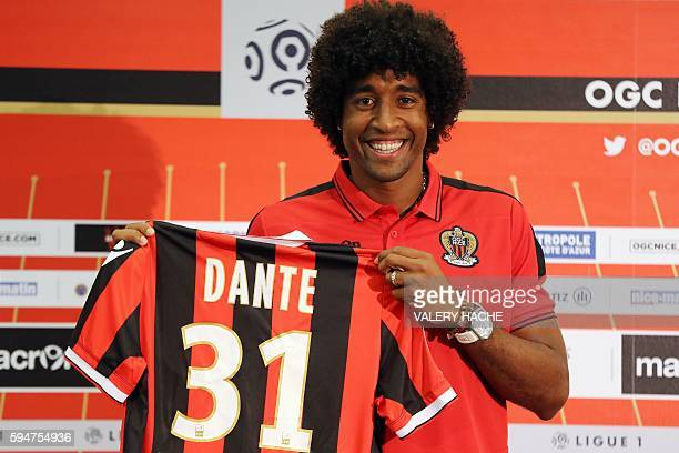 Nice's defender Brazilian Dante poses with a new jersey after a press conference on August 24 2016 at the 'Allianz Riviera' stadium in Nice...