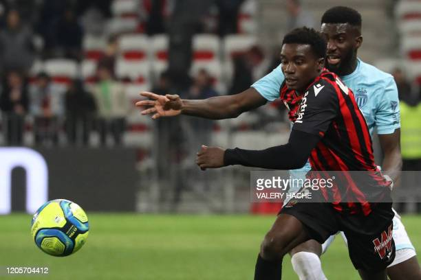 Nice's defender Moussa Wague vies with Monaco's French midfielder Tiemoue Bakayoko during the French L1 football match Nice against Monaco on March...