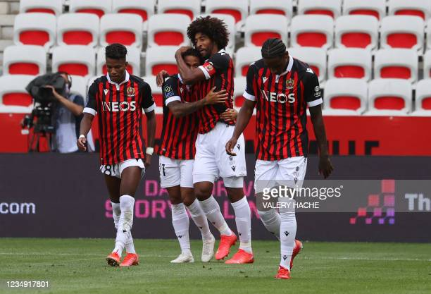 """Nice's Dutch forward Justin Kluivert celebrates with teammates after he scored a goal, during the French L1 """"Huis clos"""" football match between O.G.C..."""