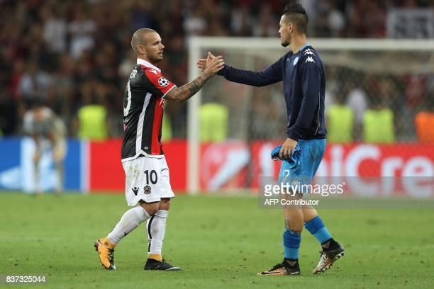 Nice's Dutch midfielder Wesley Sneijder congratulates Napoli's Slovakian midfielder Marek Hamsik after the UEFA Champions League playoff football...