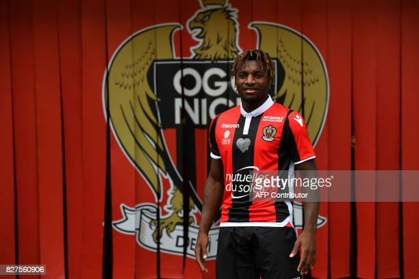 Nice's football club new signing French midfielder Allan Saint-Maximin poses on August 8, 2017 at the Allianz Riviera stadium in Nice, southeastern...