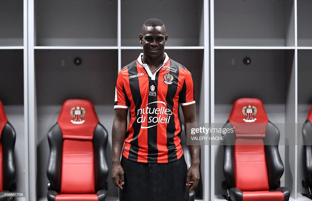 TOPSHOT - Nice's football club new signing Italian forward Mario Balotelli poses on September 2, 2016 at the Allianz Riviera stadium in Nice, southeastern France. / AFP / VALERY
