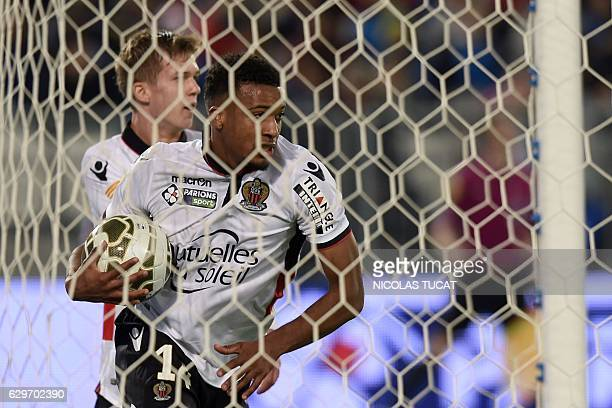 Nice's forward Alassane Plea reacts after scoring a goal during the French League Cup football match between Bordeaux and Nice on December 14 2016 at...