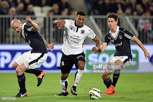 Nice's forward Alassane Plea vies with Bordeaux's French defender Nicolas Pallois before scoring a goal during the French League Cup football match...