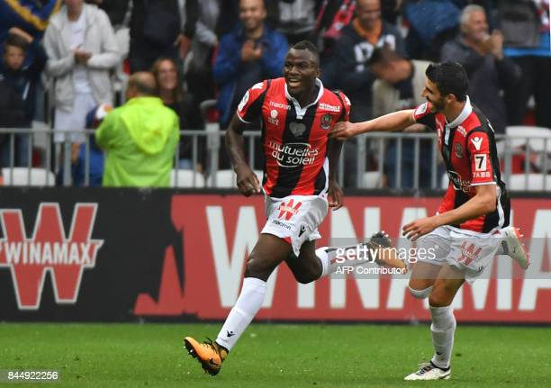 Nice's forward Kpene Ganago Ignatius celebrates with Nice's french midfielder Pierre LeesMelou after scoring during the French L1 football match Nice...