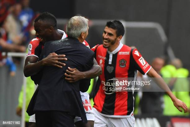 Nice's forward Kpene Ganago Ignatius celebrates with Nice's Swiss head coach Lucien Favre after scoring during the French L1 football match Nice vs...