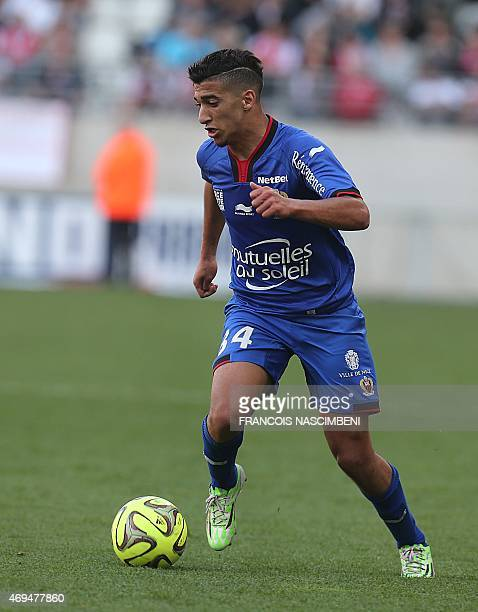 Nice's forward Mohamed Benrahma controls the ball during the French L1 football match between Reims and Nice on April 12 2015 at the Auguste Delaune...