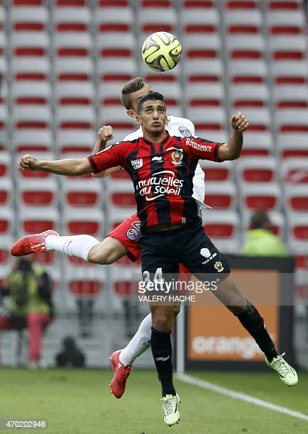 Nice's forward Mohamed Benrahma vies with Paris SaintGermain's French defender Lucas Digne during the French L1 football match between Nice and Paris...