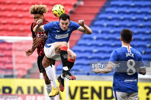 Nice's French Alexandre Duville Parsemain vies with Rangers FC's English defender George Edmundson during the friendly football tournament match...