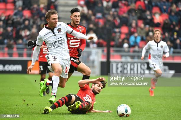 Nice's French defender Arnaud Souquet vies for the ball with Rennes'Algeria defender Ramy Bensebaini and Rennes' French midfielder Sanjin Prcic...