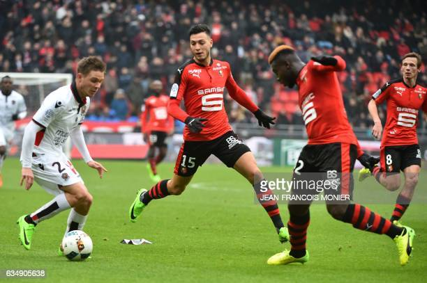 Nice's French defender Arnaud Souquet vies with Rennes'Algeria defender Ramy Bensebaini and Rennes' French defender Joris Gnagnon during the French...