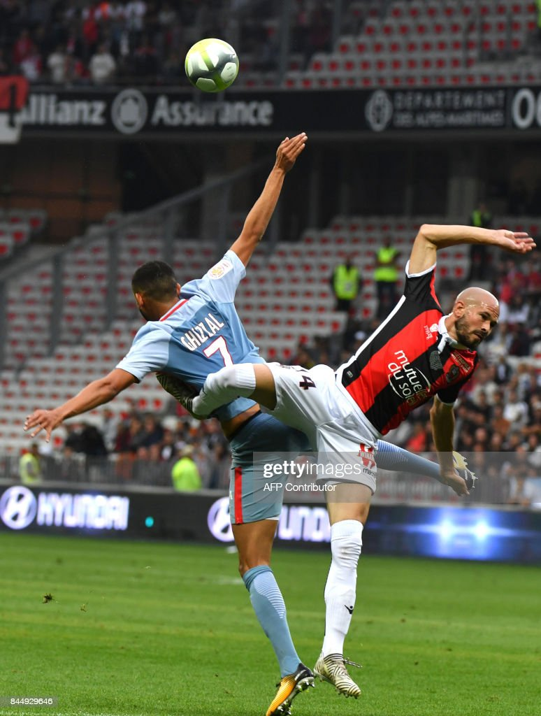 Nice's French defender Christophe Jallet vies with Monaco's French midfielder Rachid Ghezzal during the French L1 football match Nice (OGCN) vs Monaco (ASM) on September 9, 2017 at the 'Allianz Riviera' stadium in Nice, southeastern France. /