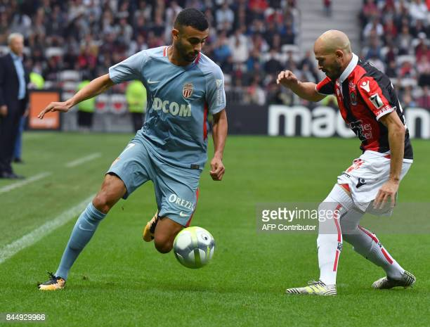 Nice's French defender Christophe Jallet vies with Monaco's French midfielder Rachid Ghezzal during the French L1 football match Nice vs Monaco on...