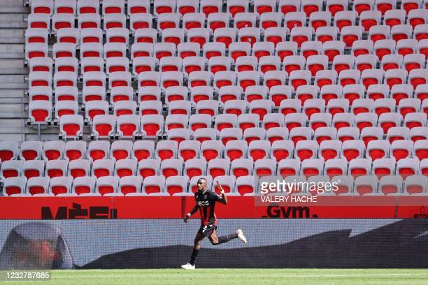 Nice's French defender Hassane Kamara celebrates after scoring during the French L1 football match between OGC Nice and Stade Brestois 29 at the...