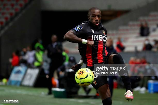 Nice's French defender Hassane Kamara controls the ball during the French L1 football match between OGC Nice and FC Nantes at the Allianz Riviera...