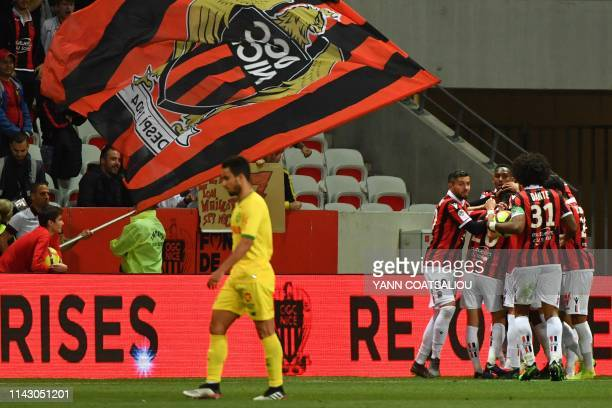 Nice's French defender Malang Sarr celebrates with teammates after scoring a goal during the French L1 football match between Nice and FC Nantes on...