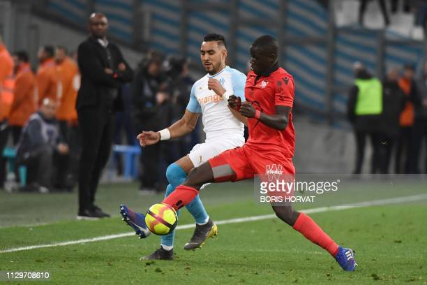 Nice's French defender Malang Sarr vies for the ball with Marseille's French midfielder Dimitri Payet during the French L1 football match between...