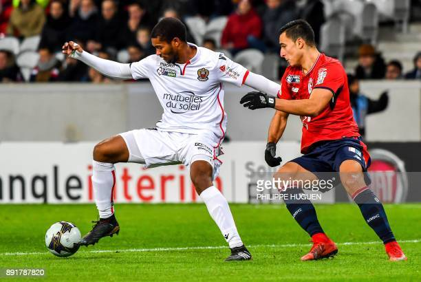 Nice's French defender Marlon Santos vies with Lille's DutchMorrocan forward Anwar ElGhazi during the French League Cup round of 16 football match...