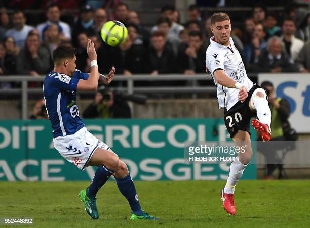 Nice's French defender Maxime Le Marchand kicks the ball past Strasbourg's French midfielder Jonas Martin during the French L1 football match between...