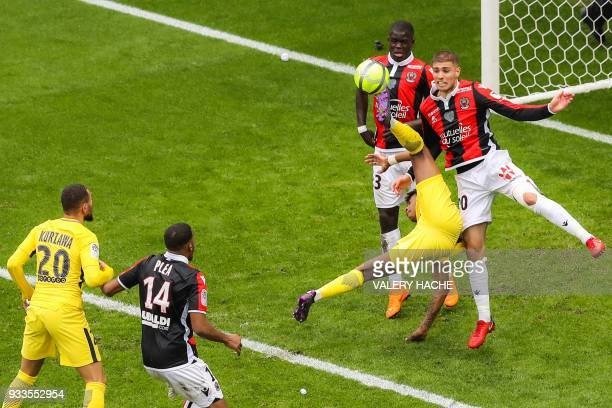 Nice's French defender Maxime Le Marchand Paris SaintGermain's French defender Presnel Kimpembe and Nice's French defender Malang Sarr go for the...