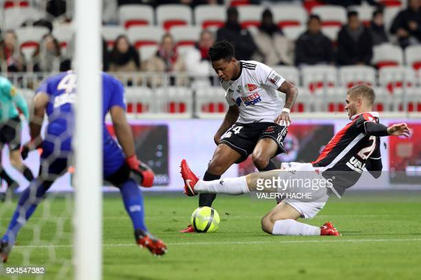 Nice's French defender Maxime Le Marchand vies with Amiens Bongani Zungu during the French L1 football match Nice vs Amiens on January 13 2018 at the...